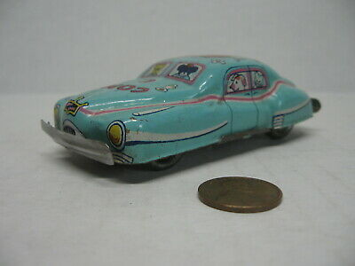 1950s Hats: Pillbox, Fascinator, Wedding, Sun Hats 1950s Tin Toy Litho Comic Car Blue #257 Dog w/Fishing Pole & Hat On Roof $19.95 AT vintagedancer.com