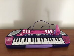 Girls Piano with microphone recording Jerrabomberra Queanbeyan Area Preview