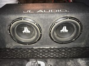 "2 10"" JL subs in box"