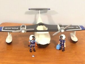 Playmobil plane with two police officers