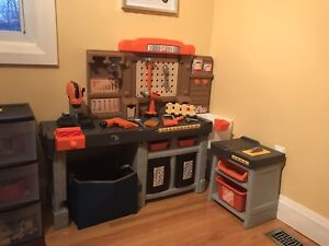 Work bench with tools and foam pieces for building