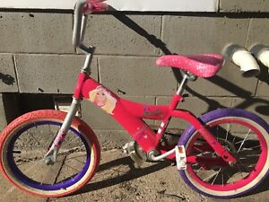 "16"" pink and and purple Barbie bike."