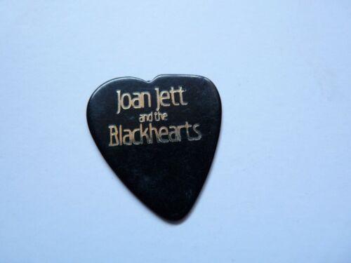 JOAN JETT GOLD ON BLACK HEART SHAPED (ERROR) TOUR ISSUED GUITAR PICK