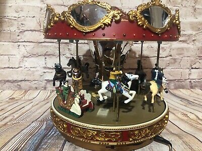 Mr. Christmas Grand Marquee Deluxe Carousel from1986 30 songs, lights, animated ()