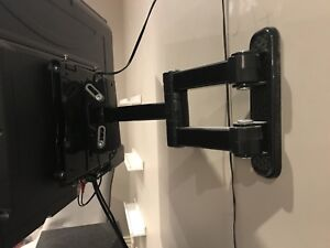MOVING SALE:  Full motion TV wall mount