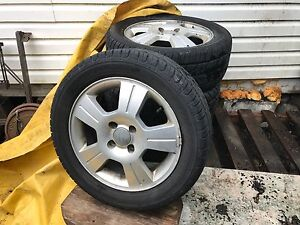 All season tires and ford rims. 205/55/16