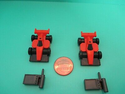Playmobil accessories SET OF TWO ORANGE TOY RACE CARS W/ TWO REMOTE CONTROLS
