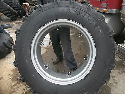 Two International B414 Tractor 14.9x2814.9-28 8 Ply Tires W6 Loop Wheels
