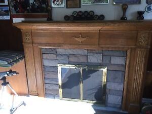 Brass and glass fireplace doors and wood mantel for sale