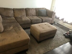 Large brown sectional.  Comes with ottoman.