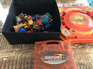 Beyblades, assorted parts, rippers, case & stadium