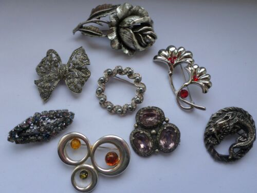 8 x vintage and modern silver toned brooches