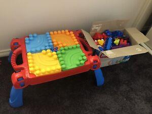 Kids mega blocks table and box of blocks