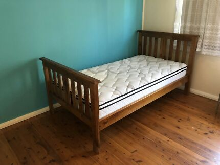 King Single bed and mattress. Almost new.
