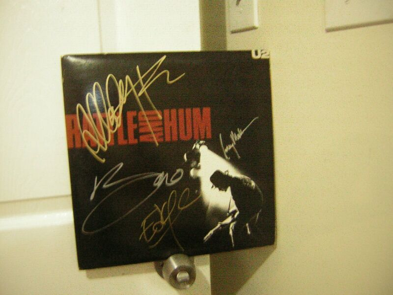 U2 signed lp **Rattle and Hum **1988**** 4 musicians of the group***