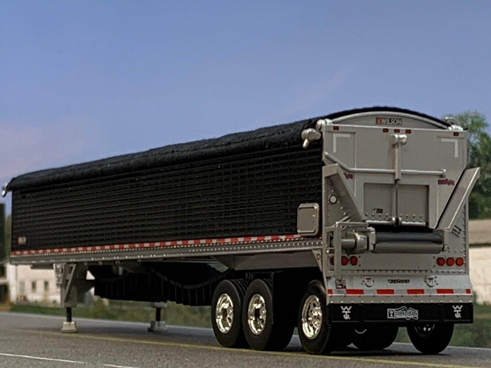 1/64 DCP BLACK WILSON PATRIOT TRI-AXLE (SUPER SINGLES) BELT TRAILER W/ BLK TARP 1
