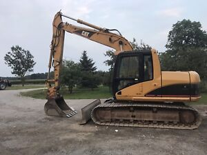 Cat 312cl with blade