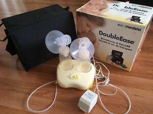 MEDELA Double Ease Electic Beastpump and Carry All Case