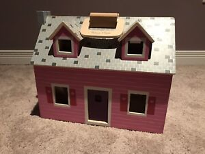 Melissa and Doug fold and go wooden doll house