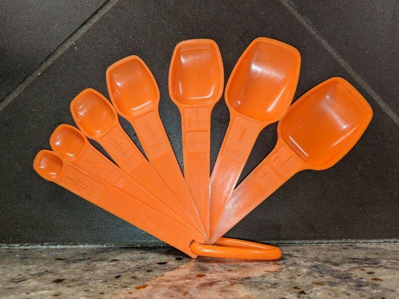 Vintage Tupperware Set of 7 Harvest Orange Measuring Spoons w/Ring 1970