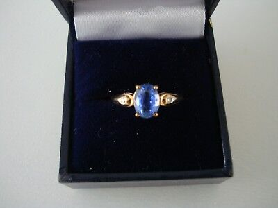 9 ct Dress Ring With Oval Blue Topaz And Diamond Shoulders