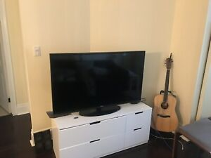 Tv, dresser and apple tv