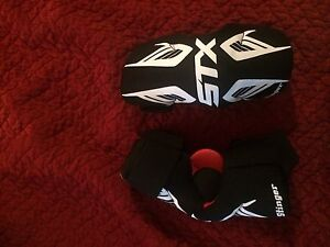 Lacrosse gloves, elbow pads, chest protector