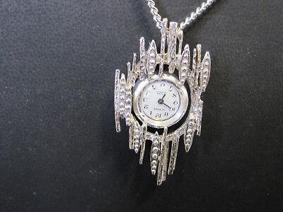 #102  ladys sterling silver LE MONDE 17 jewel mechanical  pendant watch & chain