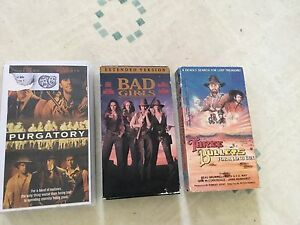 VHS Western movies. Bad girls and purgatory and three bullets.