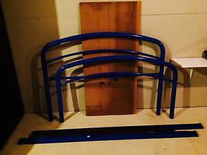 Blue metal double bed frame