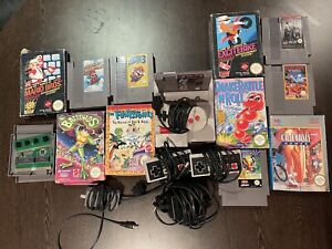 NES console 14-18 games , 3 contollers