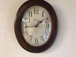 Ingraham Oval Wall Clock, Dark Wood Frame, Quartz, Domed Glass