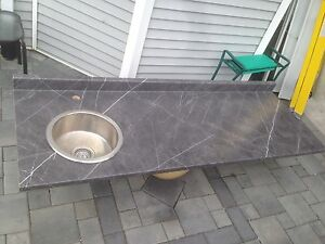Countertop with stainless steel sink.