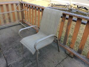 Patio chairs and glass table