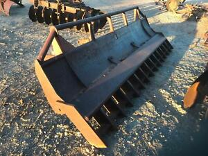 Front heavy duty dozer blade with bolt on stick rake