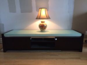 Television table with glass top.