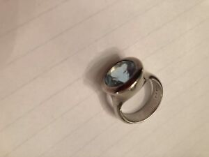 Silver ring by Elle with topaz finish