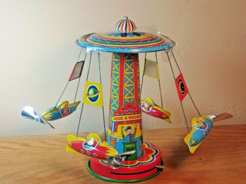 """Schylling Reproduction Tin Wind-Up """"Ride A Rocket"""" Spinning Carousel New w/o Box"""
