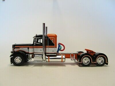 DCP FIRST GEAR 1/64 SCALE 359 PETERBILT SMALL BUNK, BLACK, ORANGE & WHITE 1