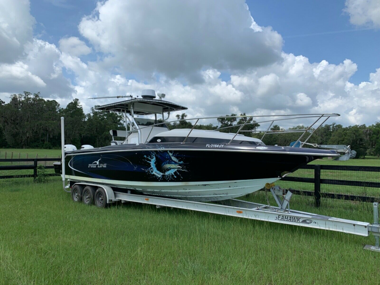 34 foot center console boat with twin 300s cuddy cabin and trailer