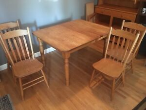 Dining room table and 8 chairs. 3 leafs included
