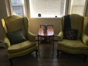 Two wing back arm chairs