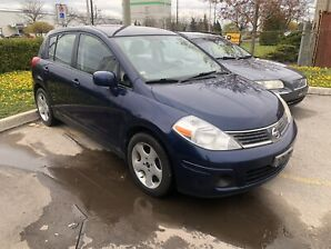 07 Nissan Versa Hatchback. Very Low Kms. 2 sets of rims:tires
