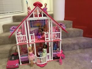 Barbie Dream House with car, bike, accessories and 9 dolls