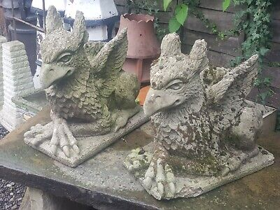 A PAIR OF GRIFFINS STATUES