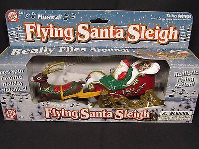 Vintage musical flying Santa in Sleigh Pulled by Reindeer 1999 ABL INNNOVATION