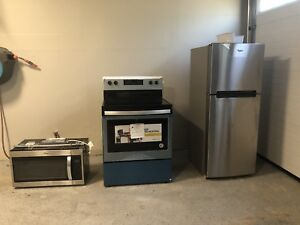 New Whirlpool Stainless  fridge, stove and microwave