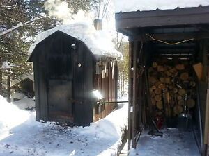 Spike Contracting out door wood Furnace