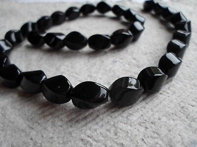 Strand of 12mm Black Onyx Twisted Rice Beads