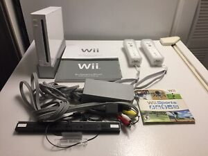 Console wii 2 manettes + 1 jeux. 100$
